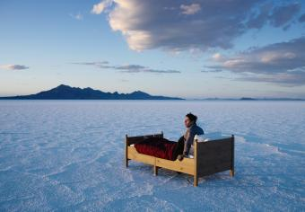 Man Waking in Bed in Salt Flats