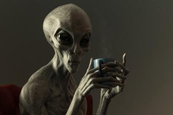 Alien Drinking Hot Beverage