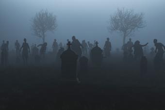 Spooky graveyard with walking dead