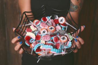 Woman offering Halloween candies