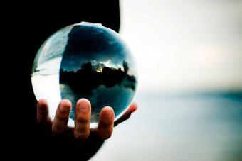 Glass ball on hand