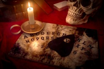 Ouija board and candle
