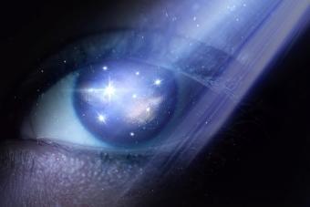Woman eye with galaxy inside