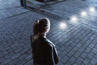 Young woman in front of glowing orbs