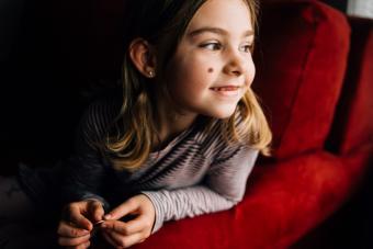 Smiling girl birthmark