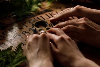 Mystic ritual with Ouija Board