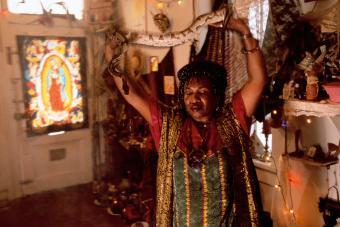 Priestess Miriam Holding Snake Voodoo Spiritual Temple