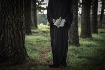 Druid reading In Forest