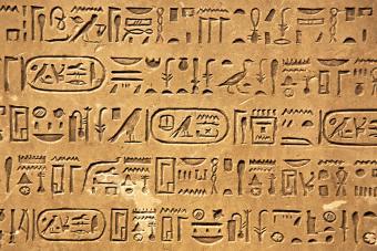 Egyptian hieroglyphs carved in sandstone