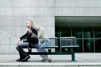 Ghost of woman embracing young man on bench