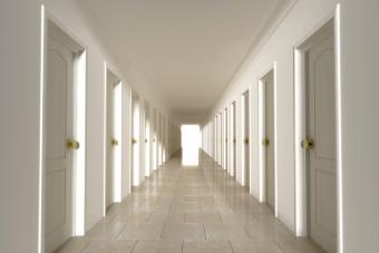 Long corridor with closed doors on the two sides