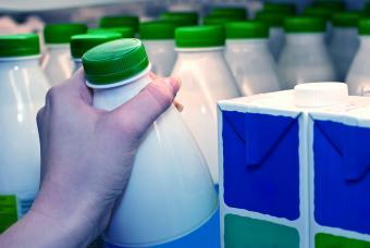 Hand grabbing milk bottle