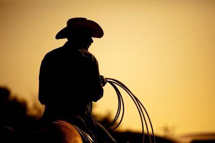 Photo of a Texas cowboy riding and roping