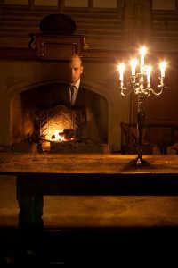 Ghostly man behind table