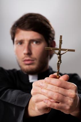 174925-284x425-priest-with-crucifix.jpg