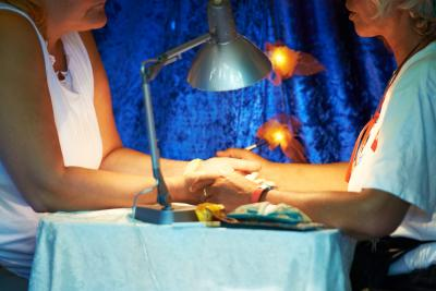 woman getting reading at psychic festival