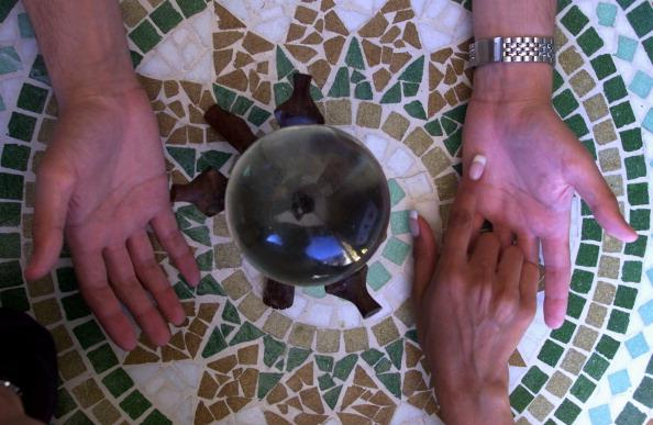 psychic doing a palm reading