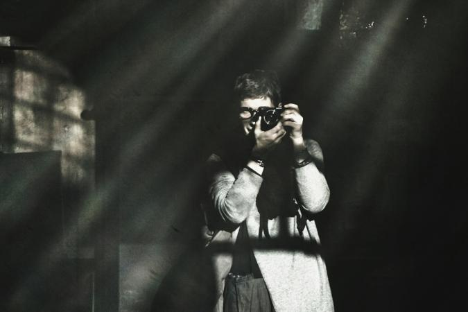 Man photographing in a dark room