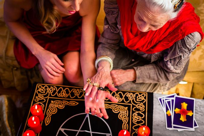 Psychic doing palmistry