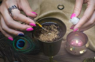 Woman preparing a magic potion