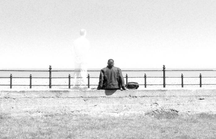 Man Sitting By Ghost