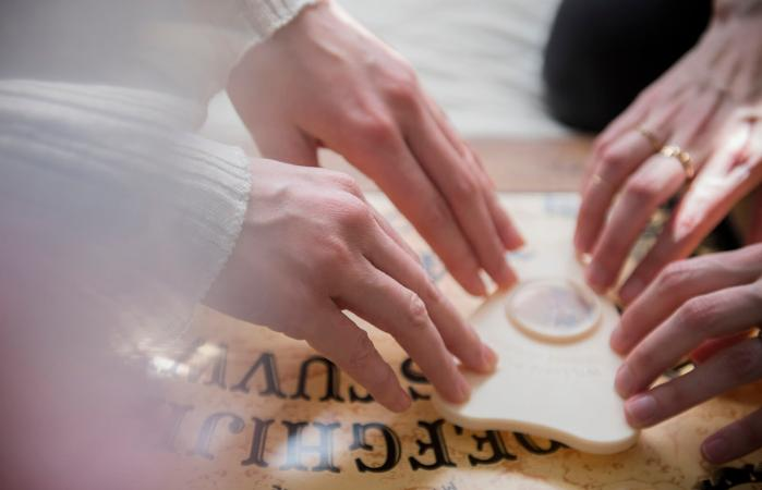 women using a Ouija board