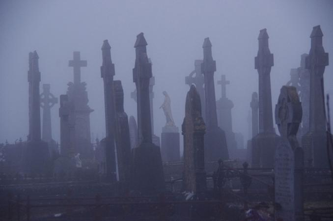 Scary cemetery at night in fog