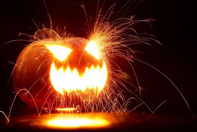 Scary Jack-o-lantern lit by a sparkler