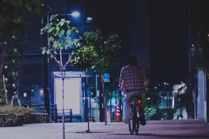 Boy on bike at night