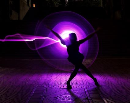 Woman dancing in purple light