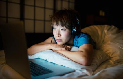 Woman watching videos on laptop