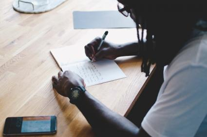 Man doing automatic writing in diary