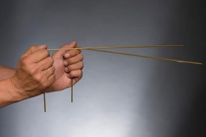 Man holding dowsing rods with hands