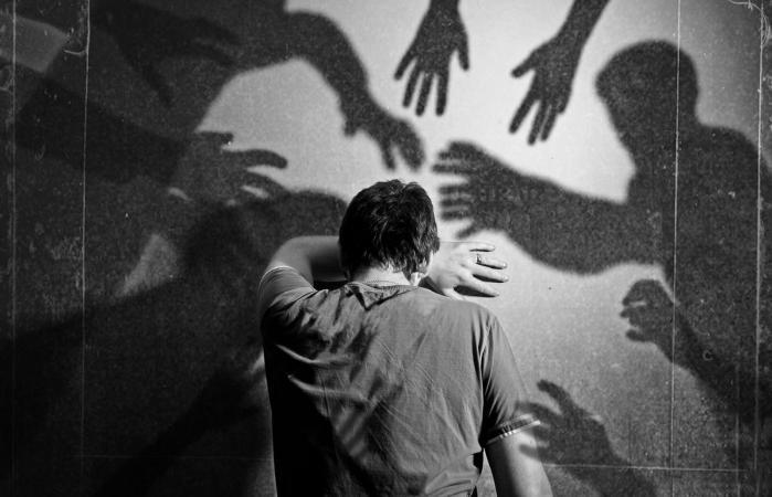 Shadows surrounding man ghosts poltergeist spirit