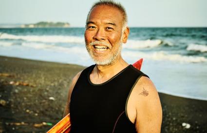 Surfer man with a spider birthmark