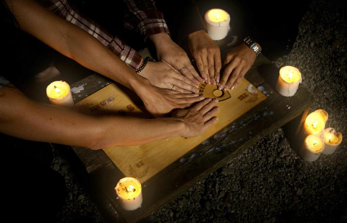 Hands on ouija board