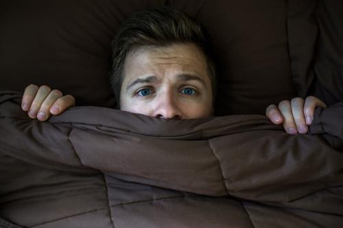 Man experiencing sleep disturbances