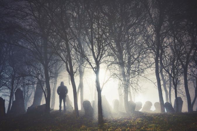Light shining through fog in graveyard