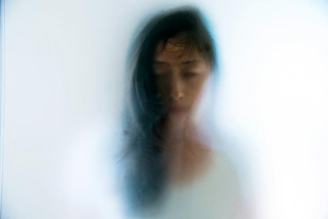 ghostly image of an asian woman