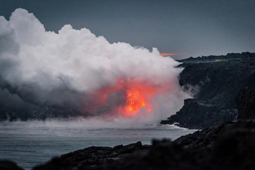 Hawaiian volcanic flow meets ocean