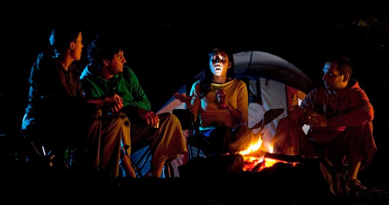 telling ghost stories around a campfire