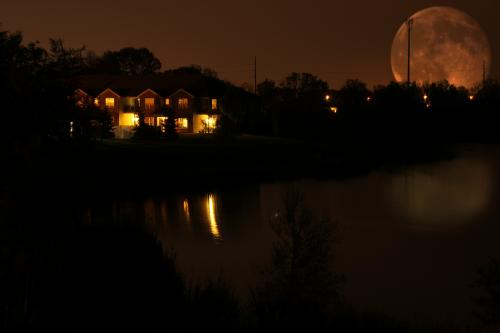 Full moon behind a house