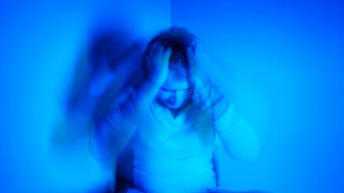 Agitated man on blue background