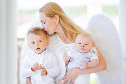 Guardian angel holding children