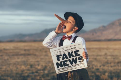Newsboy with fake news