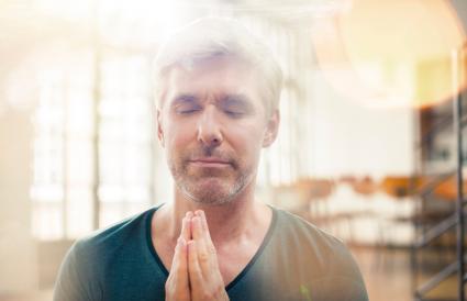 Older man praying