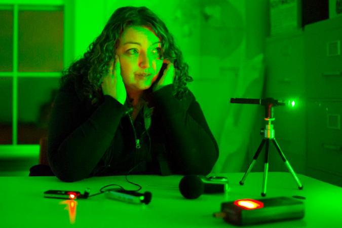 Jeni Dyer listens to device