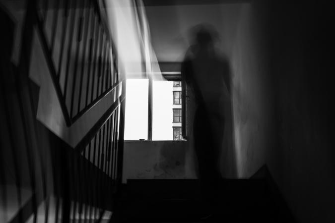 Ghostly figure on stairs