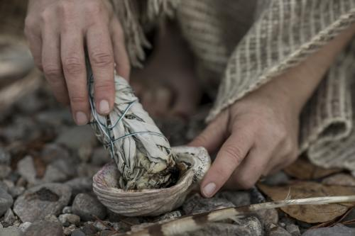 Sage with feather and shell
