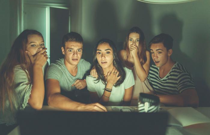 College students watching paranormal videos